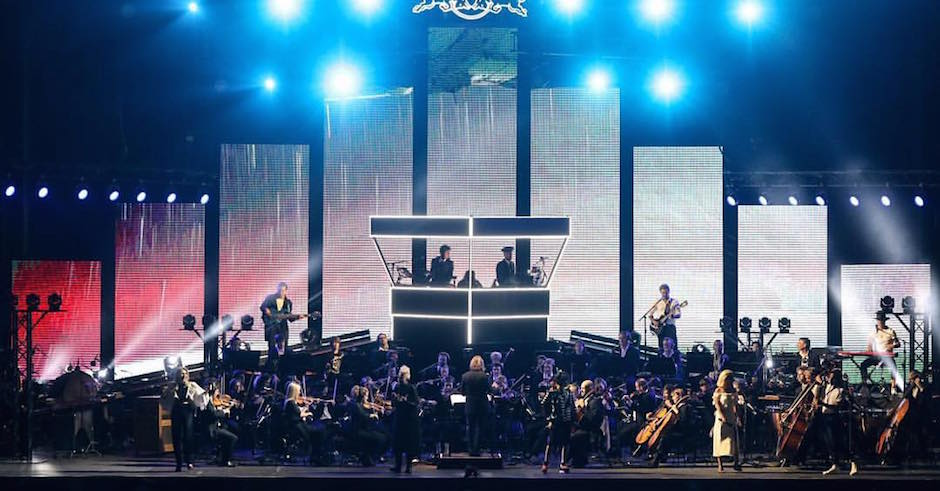 Watch bloody John Paul Young join Flight Facilities and the SSO for Love Is In The Air