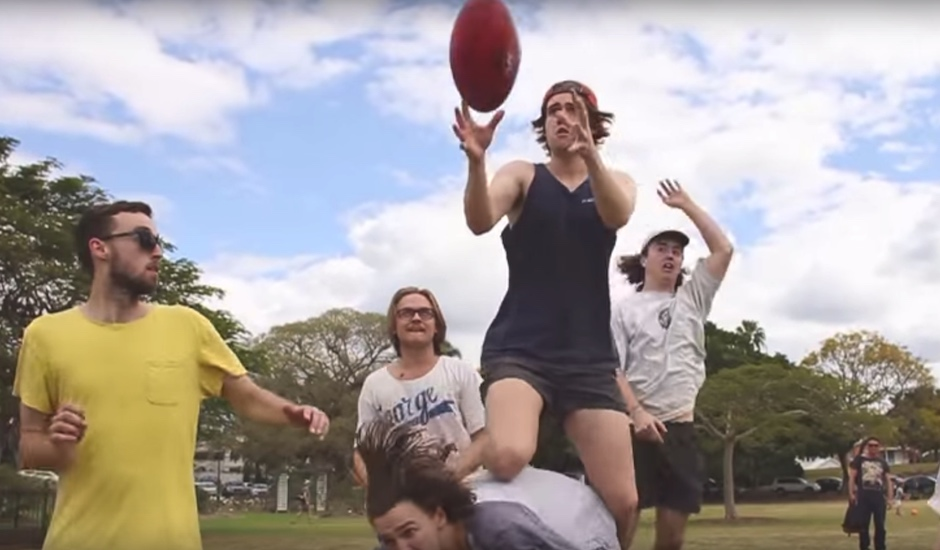 Premiere: Good Boy crack a few tinnies and kick the footy in new video clip