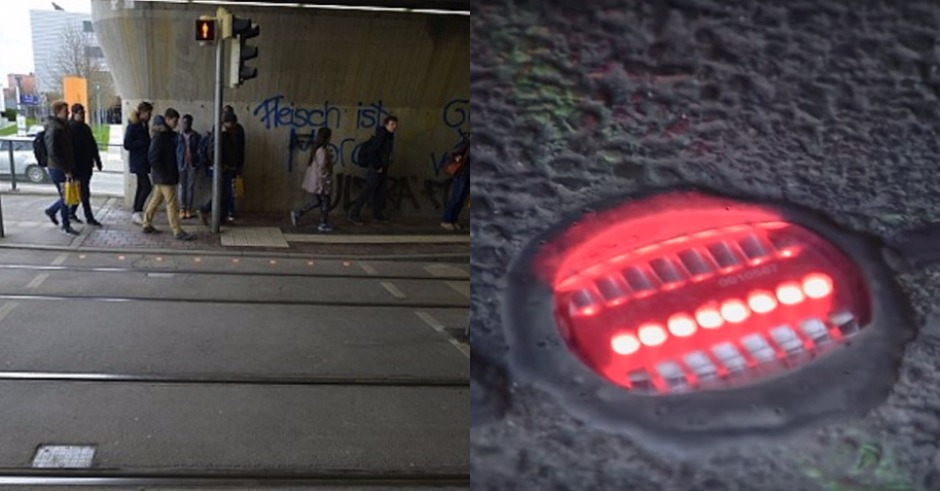 German town installs traffic lights on ground for people on their phones to see
